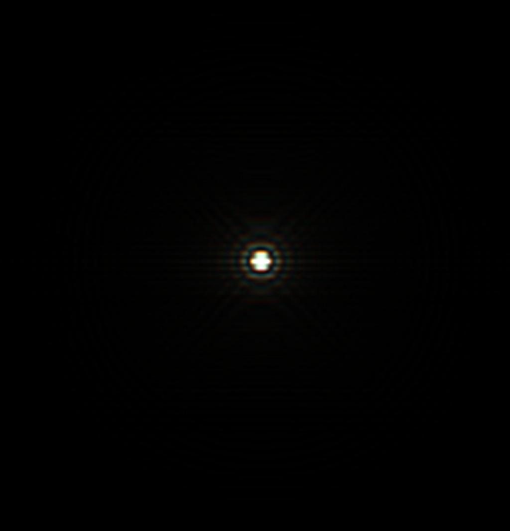 Csillag diffrakciós képe két kerek lyukú Hartmann maszkkal, tökéletes fókuszban